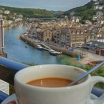 Cup of tea on the balcony in room 4 looking out at East Looe.