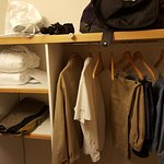 Open closet/storage by door.