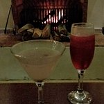 Cocktails next to the fireplace next to the bar.