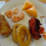 Starting at 9 O'clock, fish, shrimp at 11, cantaloupe at 1, bacon wrapped scallop at 3, pork rib