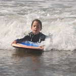Isa the youngest. having fun in the surf
