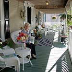 Staff member, Sharon, on the porch.