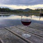 Enjoying a Pinot Noir by the dock