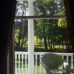 Seating on wrap around porch through sitting room window