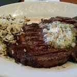16oz ribeye with rice and garlic and herb butter