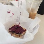 Partially devoured blueberry pop tart and iced caramel latte