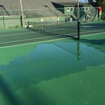 The puddle of water on the tennis court for all 3 days we were there