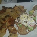 Breakfast Feature Advacado Toast with poached egg, sliced radish , cracked pepper& feta cheese