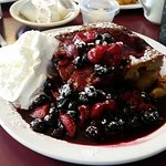 Amazing french toast! Sweet potato bread with apples baked in and covered with stewed berries. T