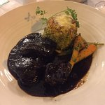 Slow braised beef á la Niçoise with potato dauphinoise and Vichy carrots
