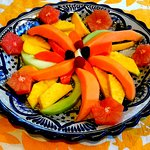 Fresh fruit served with hot entrees and fresh baked pastries and bread