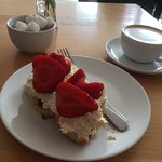 Not your classic scone with cream and jam. More like a strawberry pudding. Good but not what I w