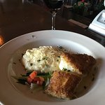 Parmesan Crusted Grouper with Lemon Beurre Blanc Sauce.