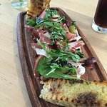 The cured meat focaccia with Prosciutto, Salami and another unidentified meat.