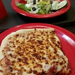 Lunch special with slice of cheese pizza and Greek side salad.