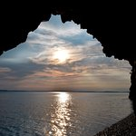 Sunrise view from inside one of the caves (the Ovens) on the beach.