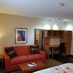 One Queen Bed Suite Living Area