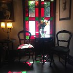 Gorgeous sunlit corner in the downstairs sitting area. Sweet breakfast courtyard is just outside