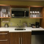 In-room kitchen...with all the dishes and silverware you could need!