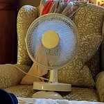 No safe, no mini fridge, no ventilation except for this sad fan propped on a chair drug to the f