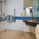 Accessible wet room with roll in shower, seat and alarm cord