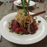 Steak with quinoa & vegetables & soggy fried onion strips