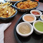 fries, tater tots, and a colorful array of dipping sauces