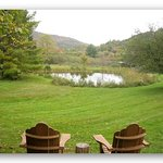 chairs over looking pond and mountains