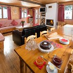 Chalet Dahu living and dining room with log fire
