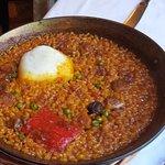 arroz con bacalao, pimientos y ceps