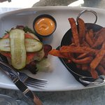 Bacon and Gouda burger w/o mushrooms or bun, with onions and sweet potato fries.