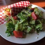 Pita wrap with lemon chicken and Greek salad