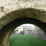 View of Front Exterior of Hotel through the Archway of a section of wall surrounding Trim Castle