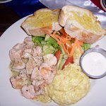 Lime shrimp with mashed potatoes and salad.