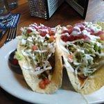 Grilled halibut lime tacos. Needed more halibut. Taco shells should be more crispy.