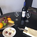complimentary fruit platter, chocolate and wine