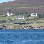 View of chalets from boat trip to Summer Isles.