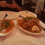 Lamb Biryani (Right), Butter Chicken (Left)