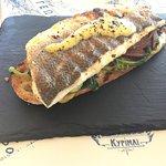 Fish & bread with sea bass, syglino, rocket, honey-mustard sauce.