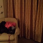 Sorry about the clothes in photo notice how old the curtains carpet and furnishings are