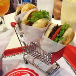 Mini burgers served in a tiny shopping cart!