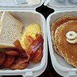 Buttermilk Pancakes, sour dough toast, eggs, bacon and polynesian sausage