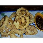 Onion rings with a soy-based dipping sauce