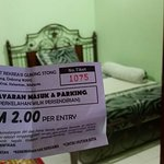 My waterfall ticket and in the background my luscious room at Rose House Dabong!