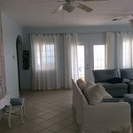 Very large front to back open living room space with french doors opening out to balcony: 2 BR/2