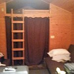 Main living areawith 2 futons, notice ladder to small loft with one mattress