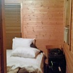 The one small bedroom - comfortable mattress, small closet, window A/C unit