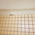 Walpaper falling off walls