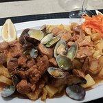 pork meat with clams and potatos
