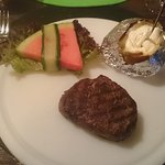 Tenderloin steak with jacked potato, and three different sauces (not shown in picture).